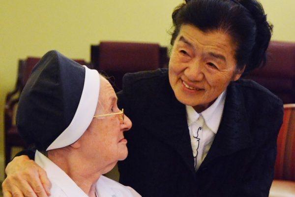 Sisters greet each other and catch up at Sarah Community in Bridgeton, Missouri.