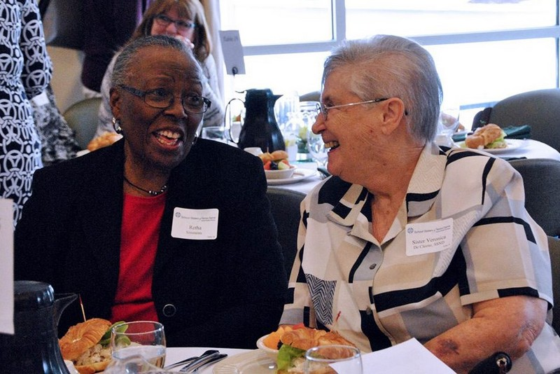 Sister Vonnie De Cleene caught up with a friend at the Women's Leadership Luncheon in Elm Grove, Wis.