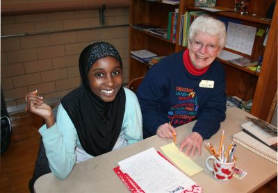 Samaya and Sister Therese Ann Zanmiller work on essay writing.