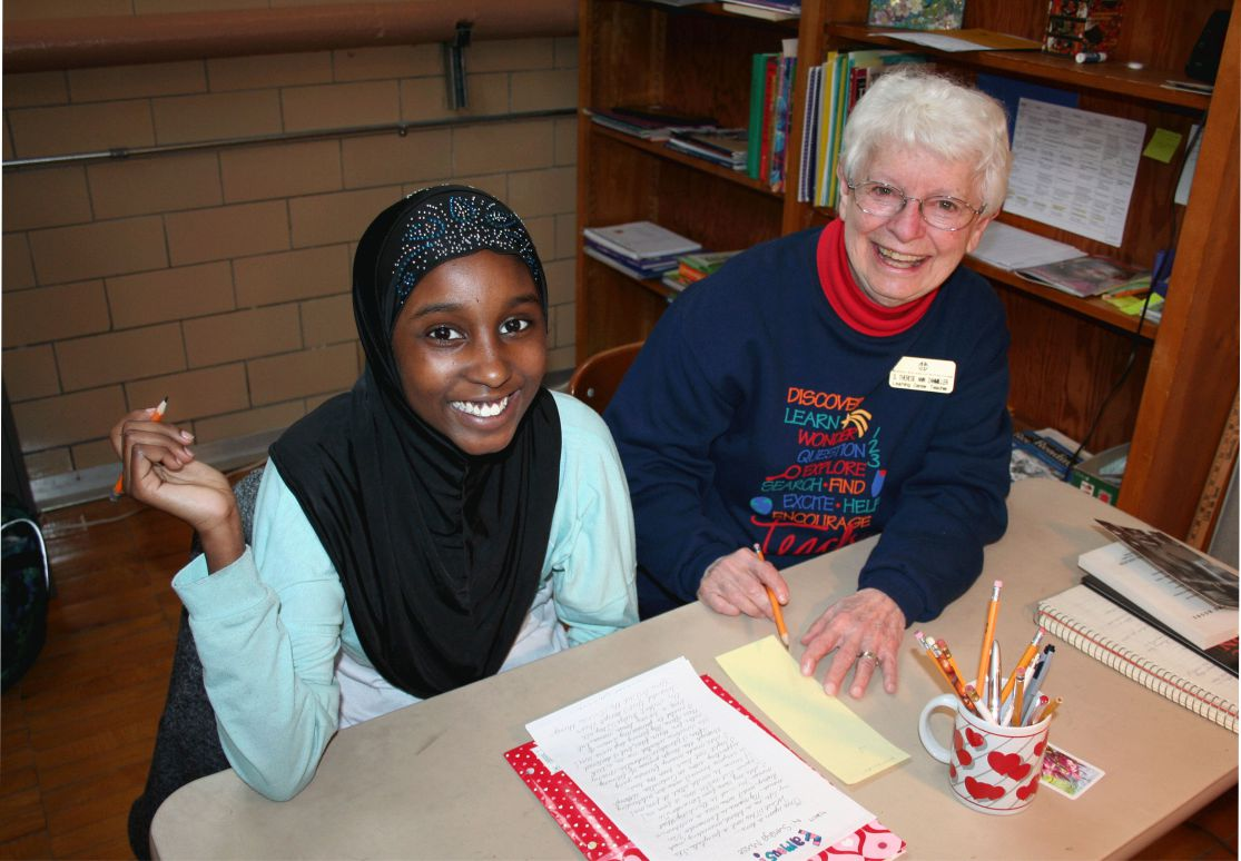 Samaya and Sister Therese Ann Zanmiller work on essay writing.