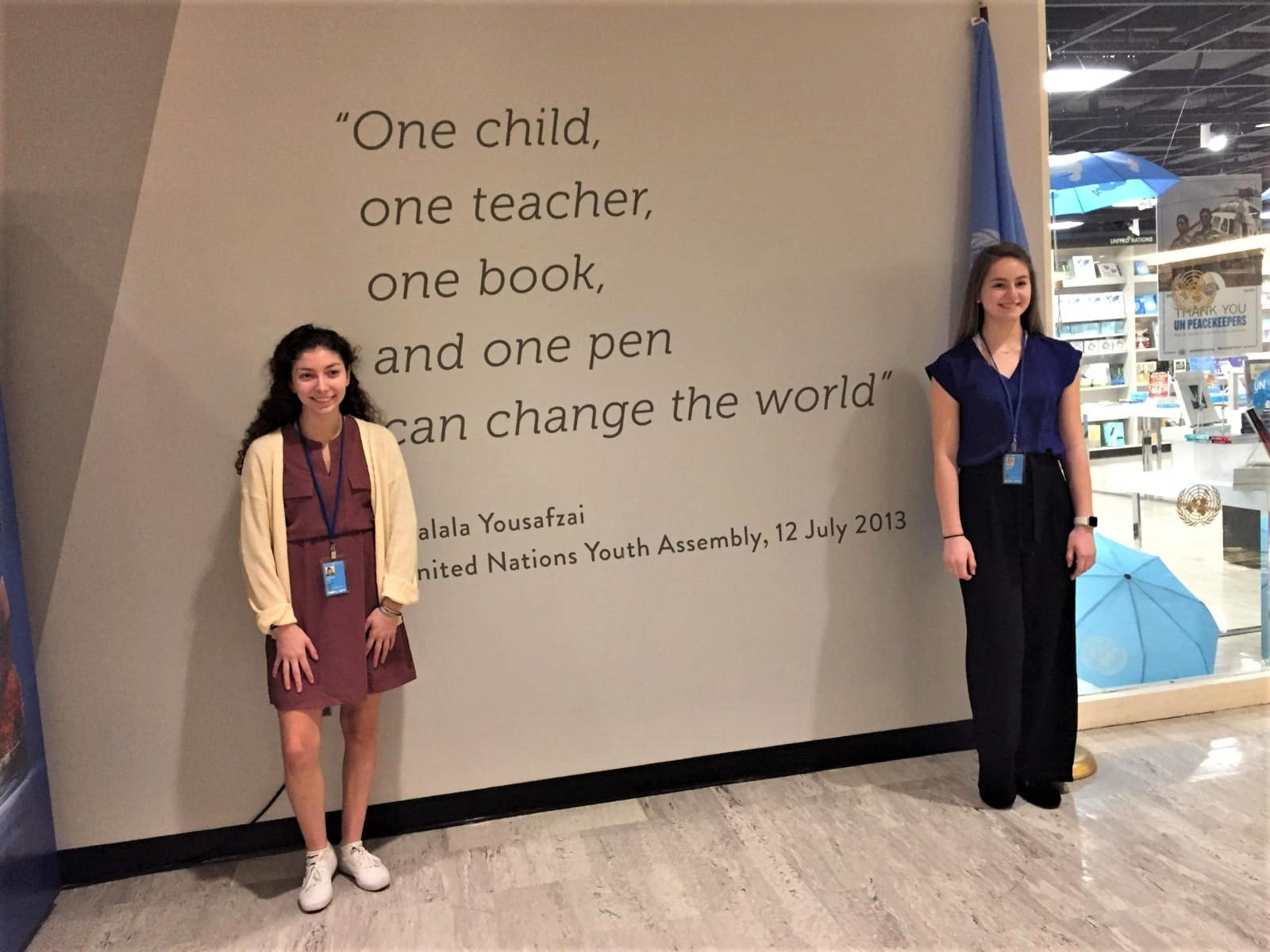 Faith and Chloe beside one of our favorite quotes.