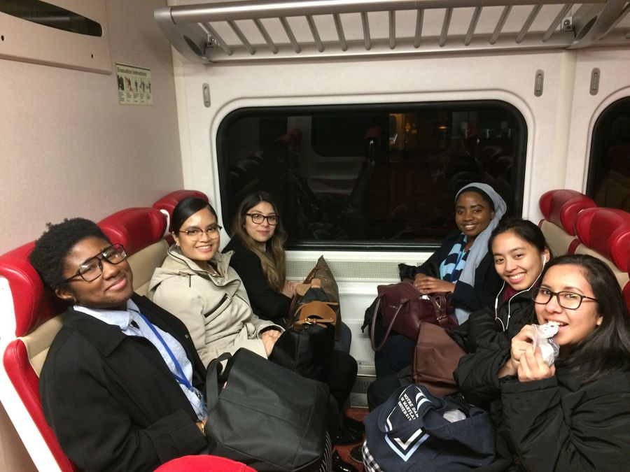 NDMU students on the train heading to CSW63. Left: CJ, Mary Grace, Jeannette; Right: Katherine, Christine, Tavia